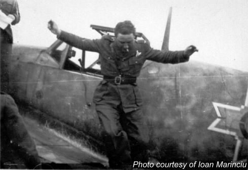 Adj. av. Ioan Marinciu jumping out of his Bf-109 smoking. Note the stencil style Michael Cross.