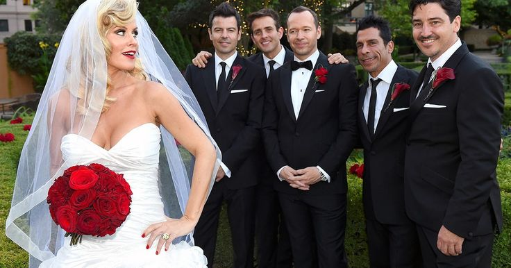 Wahlberg's New Kids on the Block bandmates Jordan Knight, Joey McIntyre, Danny Wood and Jonathan Knight served as groomsmen. The guys posed for pictures together while McCarthy gave a little sass as she held her bouquet of red roses.
