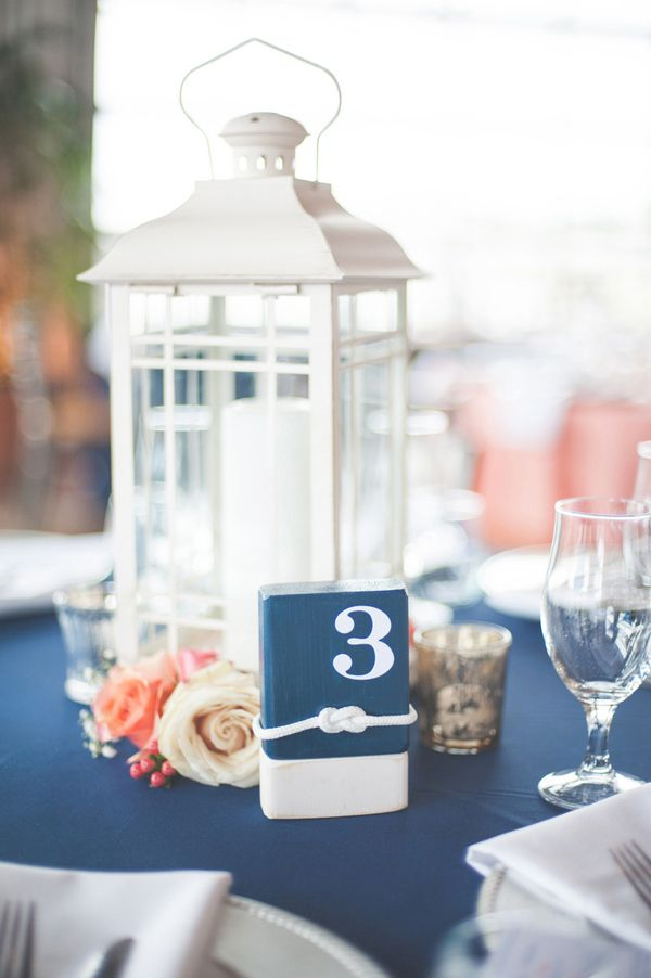 Nautical Rope and Buoy Table Numbers with Lantern Centerpieces  | Shannon Moffit Photography | Classic and Elegant Navy Blue and Coral Nautical Wedding