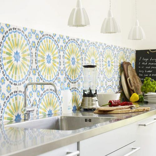 Colorful backsplash in a black and white kitchen. is that stainless steel countertops?? love it.