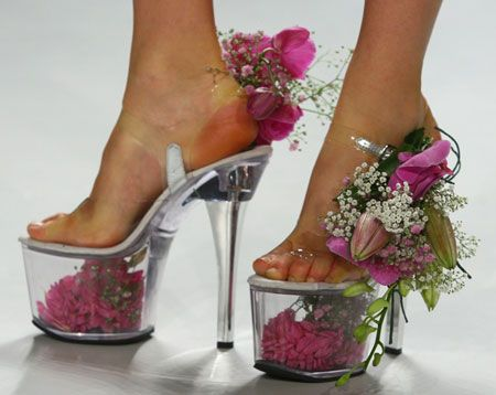 Constanze Gonzalez and Paul Scherer 2009 runway show: flower vase shoes with pretty pink blooms...