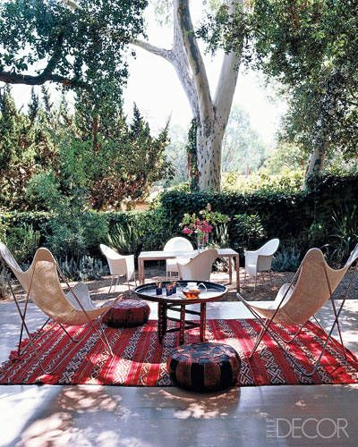 We love the mix of a modern outdoor dining table and chairs juxtaposed with a chic Moroccan lounge.
