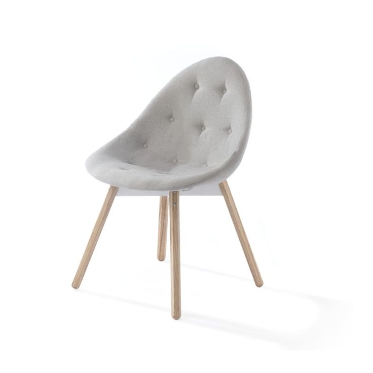 Source Upholstered chair    Designer: Haldane Martin    The source dining chair, with its shapely buttoned upholstered seat is the most comfortable chair in the source family.