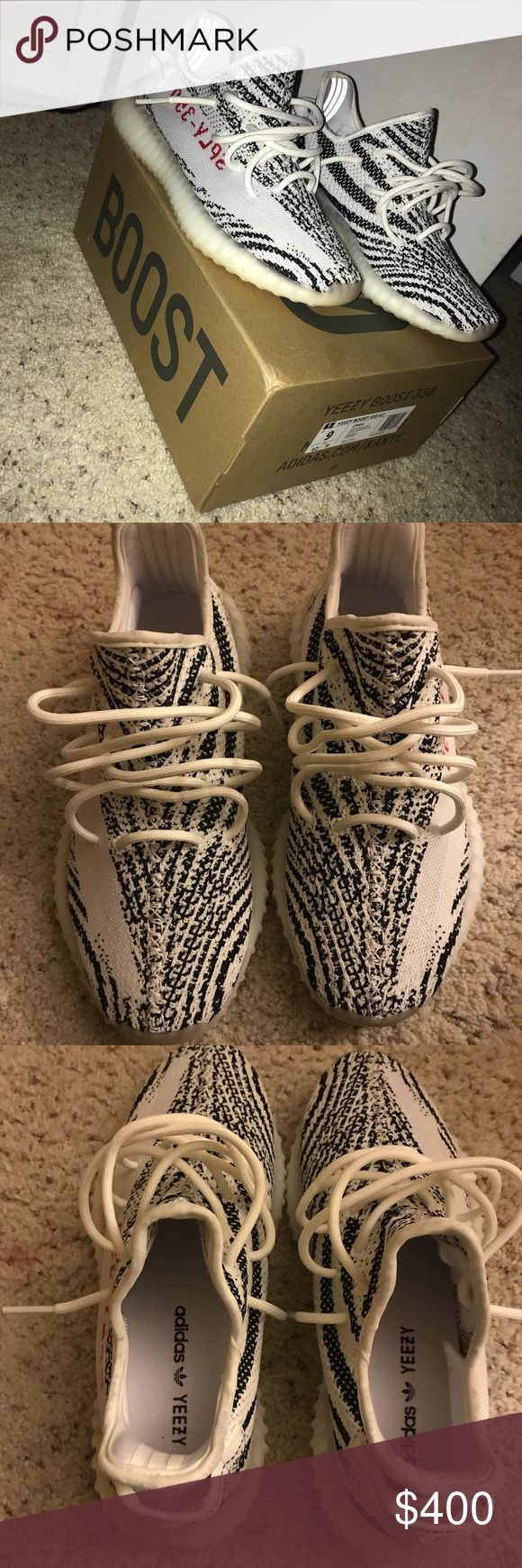 Authentic Zebra Yeezy 350 Boost V2 Worn a few times and still in phenomenal condition. Paid 600 at flight club. Only comes with shoes and box, my dog tore up the original paper sorry. If you're gonna make accusations of fakes please just leave thank you. Dropping price low due to tattoo appointee next week must go ASAP Yeezy Shoes Sneakers
