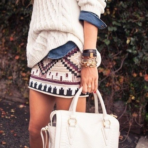 Loose sweater over jean shirt, with a tribal body con skirt. Check, check, check.