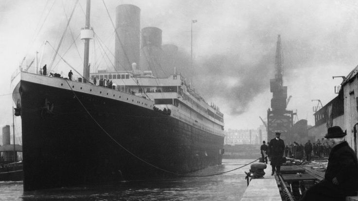 Black and white image of the ship Titanic at a wharf