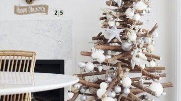 Bekijk 'Binnenkijken bij Marlou & Jurre' op Woontrendz ♥. In kerststijl met een houten kerstboom en leuke kerstdecoratie.
