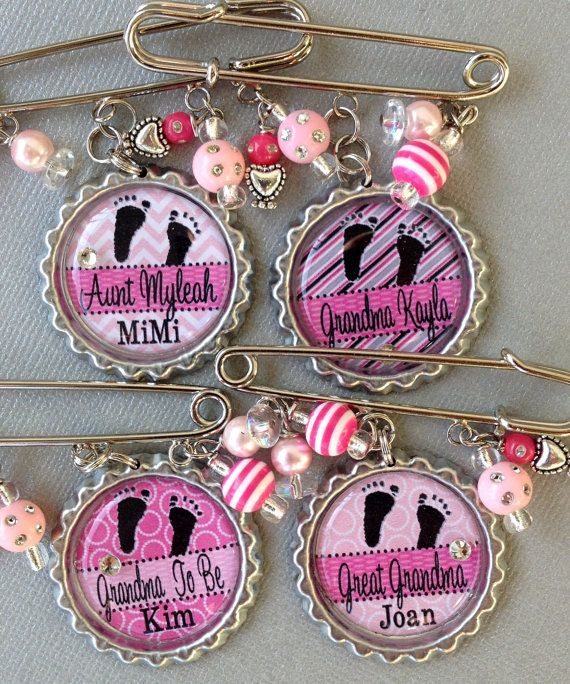 PERSONALIZED Bottle Pins: by buttonit - these would be a special touch and a nice little gift for the grandma's, great-grandma's & aunts to wear at a baby shower. If you are really crafty I am sure you could possible make this a diy and make something similar.