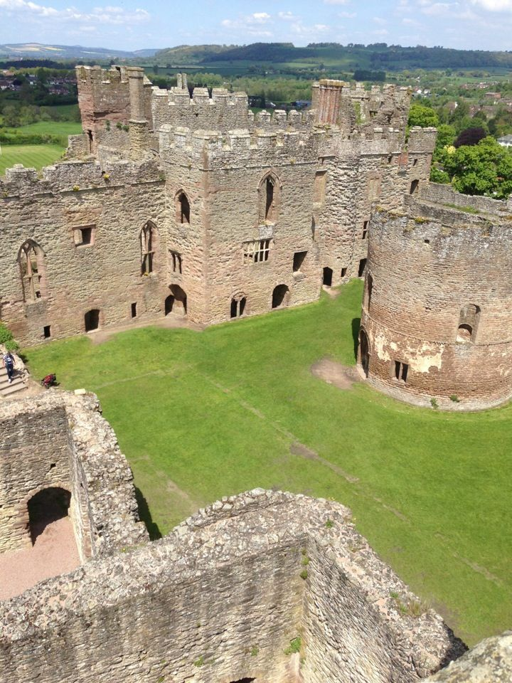 Ludlow Castle courtyard including the round Chapel, Shropshire, England, UK. Ludlow Castle is a ruined medieval fortification in the town of the same name in the English county of Shropshire, standing on a promontory overlooking the River Teme.