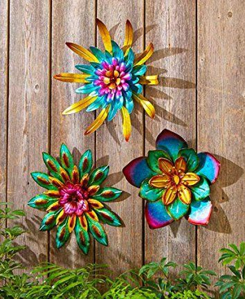 Metal Outdoor Wall Art Metallic Garden Flowers (Combo, 3 Pack)    Decorating your backyard or garden is easy, fun, and cute when you use metal outdoor wall art.  You can incorporate sun, gecko, moon , flower and all kinds of other metal wall decor that is perfect for your garden outdoor space.  This metal wall art is the epitome of style and an great start when it comes to outdoor decorating ideas.