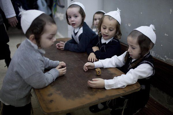 Ultra-Orthodox Jewish children play with a Hanukkah Dreidel (spinning top) at a kindergarten in the ultra-Orthodox Jewish neighborhood of Mea Shearim during Hanukkah holiday in Jerusalem, Israel, 12 December 2012. Hanukkah, also known as the Festival of Lights, is one of the most important Jewish holidays and is celebrated by Jews worldwide during eight days to commemorate the rededication of the Holy Temple in Jerusalem at the time of the Maccabean Revolt of the 2nd century BC.
