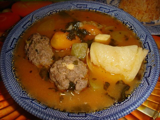 Albondigas....(Are balls of ground beef with bread crumbs, egg and parsley cooked in a broth which is then added rice and served hot. Also served in a soup called pot meatballs).