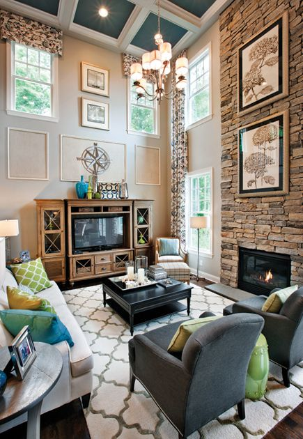 Southwick home design by toll brothers two story family room features a stone facade fire for 2 story family room window treatments