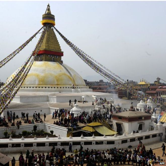 Tibetan community gather and throw flour at the Boudhanath Stupa during celebrations marking the third day of Losar Tibetan New Year in Kathmandu (March 4, 2014)
