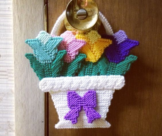 A personal favorite from my Etsy shop https://www.etsy.com/listing/125152904/tulip-doorknob-hanger-in-plastic-canvas