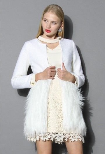 Dropping temperatures are no reason to stay inside and decline a party invite, especially with this woolen, faux fur coat. Featuring a pure snow white hue, classic longline silhouette and the beautiful fancy faux fur embellishment, this lovely outerwear will keep you warm and chic at any time. - Faux fur embellished - Round neckline - Hooks closure - Lined - 30% Modacrylic, 25% Wool, 45% Polyester - Dry clean Size(cm)Length Bust Waist Shoulder Sleeves XS       80    80   …