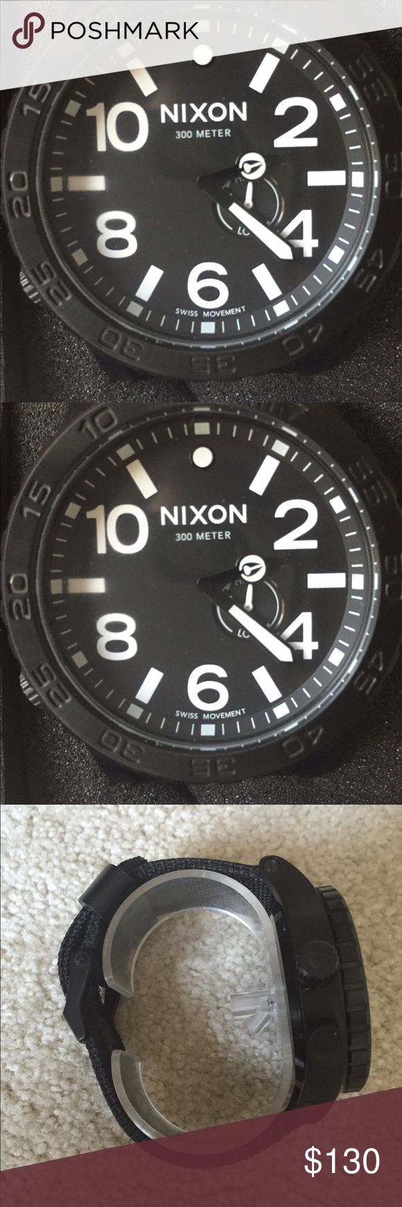 "Nixon men's black large face watch 50 mm case. Nixon ""Simplify"" mens black watch (""THE 51-30) 300m stainless steel watch. Face measures 50mm. Band is thick canvas with belt buckle take closure. Black face and black band with white numbers. Nixon Accessories Watches"