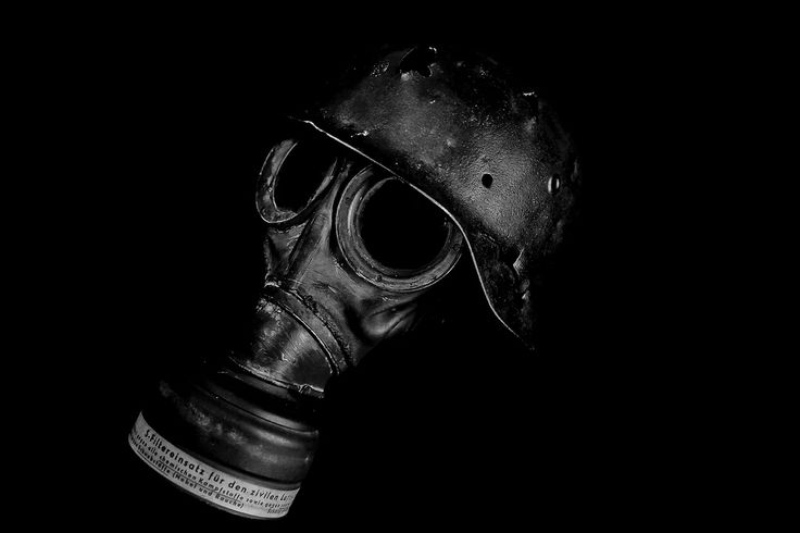 German WW2 Battle damaged helmet and gas mask.  Photography by Marc Russo