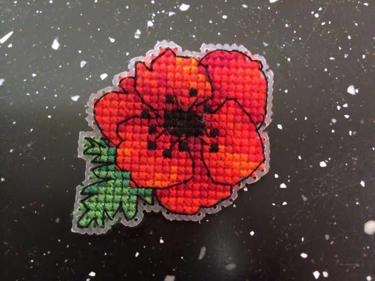 Cross stitch poppy brooch (idea & pattern from Cross Stitch Collection). Money donated to the Poppy Appeal :)