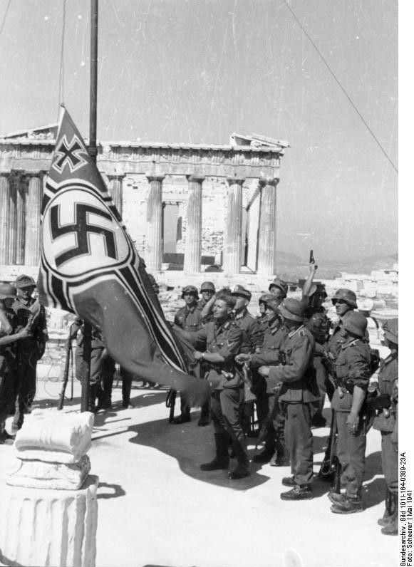 German soldiers raising the German war flag over the Acropolis of Athens, Greece, May 1941.