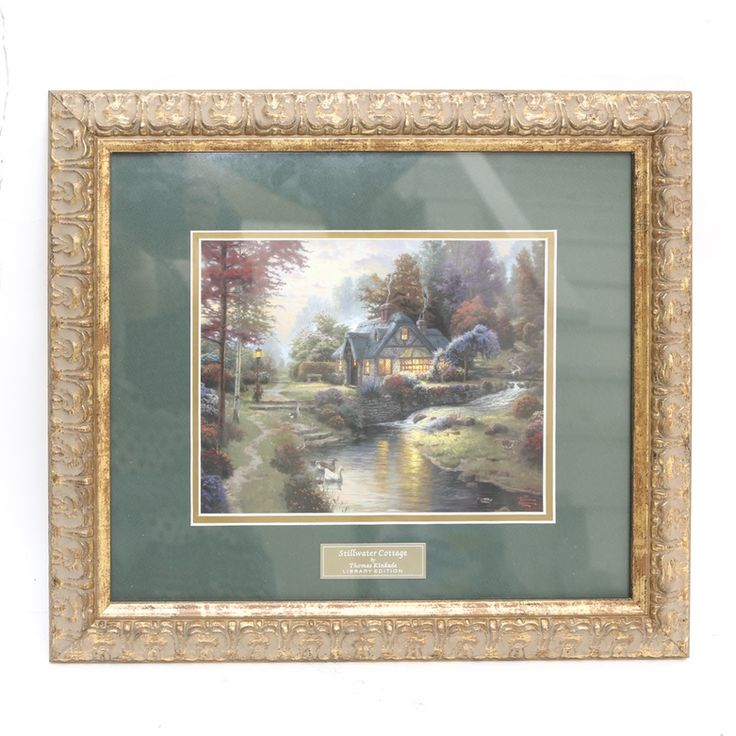 An offset lithograph titled Stillwater Cottage after Thomas Kinkade. The lithograph is matted in forest green and presented in a gilt frame. The lithograph is the Library Edition created exclusively for Home Interiors and Gifts.