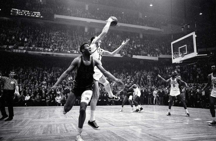 """John Havlicek - """"Havlicek stole the ball!"""" Celtics broadcaster Johnny Most's call describing the final seconds of Game 7 of the Eastern Division Finals is one of the most memorable in NBA history. Boston held on to a 110-109 victory over the Philadelphia 76ers after John Havlicek tipped Hal Greer's inbounds pass, intended for Chet Walker, toward teammate Sam Jones. The Celtics would go on to win their seventh consecutive NBA title. Eight-time NBA champion and 13-time consecutive All-Star…"""