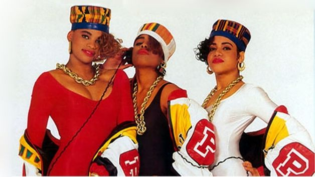 "1980-2008 Costume for Men and Women. Kente cloth became extremely popular in the 80's as a tribute to African-American heritage. Here Salt-N-Pepa wear kente cloth kufis on their album cover. This trend was the result of Public Enemy's song ""Black Is Back."""