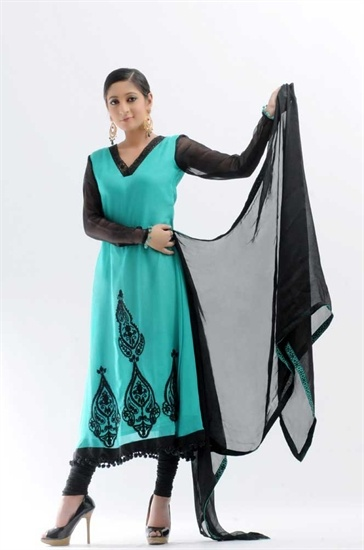 Chiffon churidar and kameez. The kameez is in a lovely green with black embroidery on the front of the shirt and there is a large motif on the back of the kameez.  The sleeves are sheer black with green balls on the cuff. The dupatta is black with a green border.  £49.99