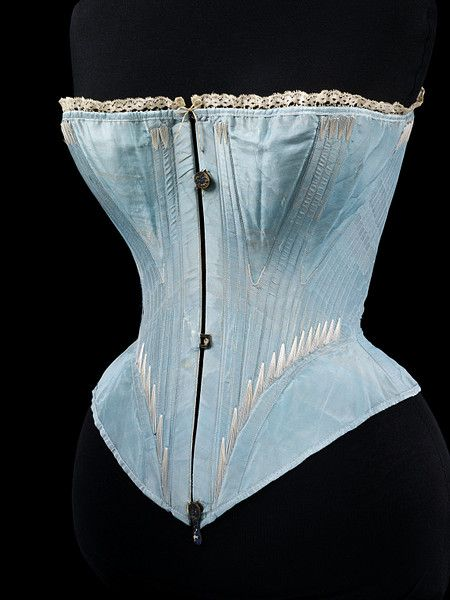 The Victoria and Albert museum dates this to app. 1864.  See how it doesn't go down the hips very much?  Hips and all points south were concealed under the hoop, so no need to rein them in.  This was a period of much more comfortable corsets than before and after.