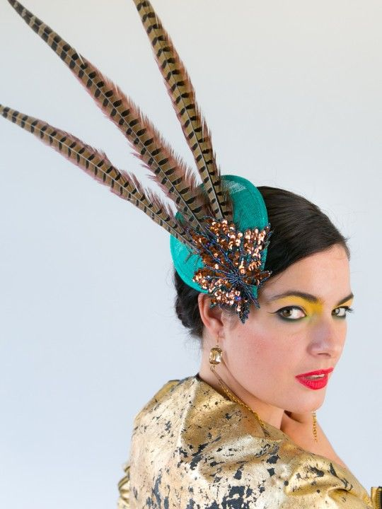 PEACOCK GLITZ | Hat/Fascinator for Melbourne Cup | FORD MILLINERY  $315  Glitz up your night or add dazzle to your Spring Racing Carnival. Peacock Glitz is on-trend, teaming animal print with bright clashing colours… Perfect for mismatched prints and bold colour mish-mashes. Jade sinamay teardrop with three long (70-80cm) golden pheasant tail feathers and bronze & turquoise sequinned/beaded motif. Secure with gold hair-comb, position back, up, sideways… You animal!