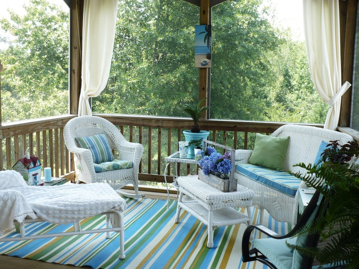 screened porch decorated in blues and whites