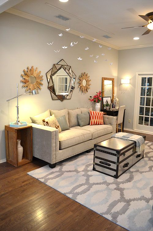 Living room with @west elm Ikat links rug, @Wisteria mirror and a DIY mobile above the sofa. Wall color: Revere Pewter by Benjamin Moore