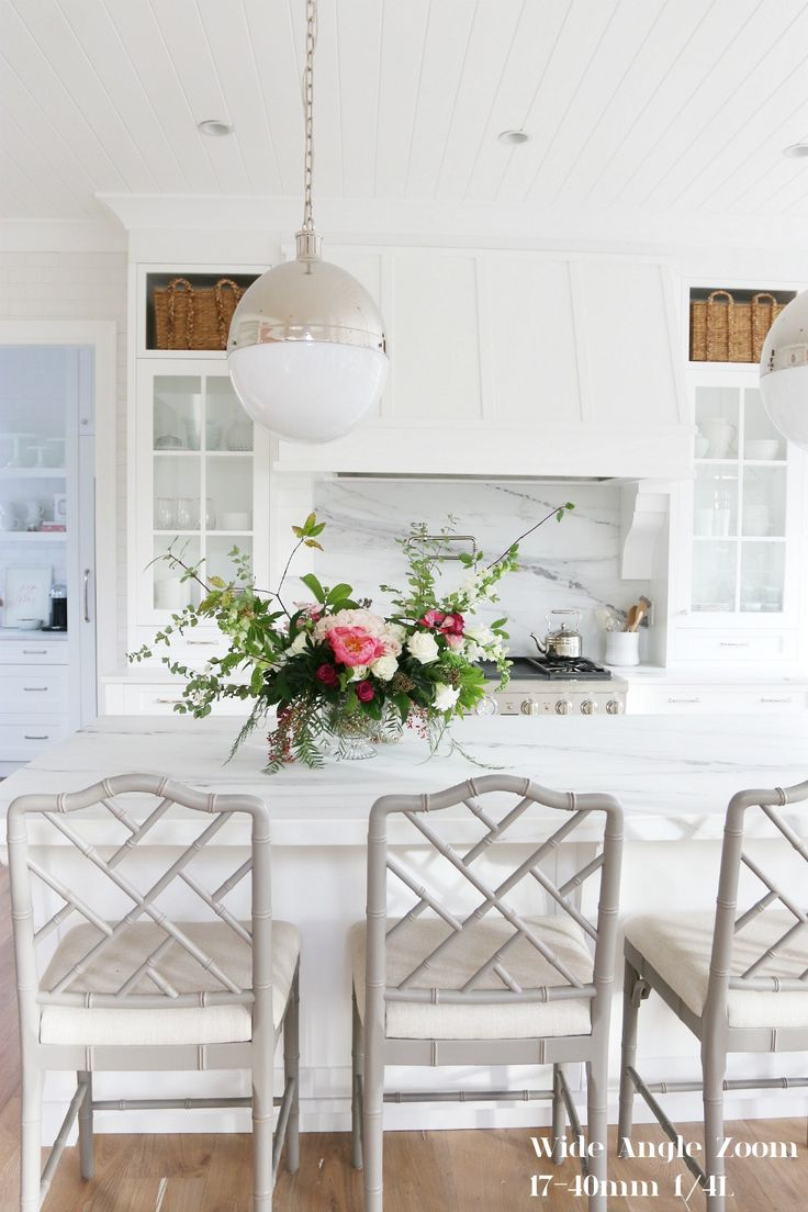 Modern kitchen island chairs - Gorgeos White Kitchen With Marble Countertops Chippendale Chairs And Globe Pendants Over Island