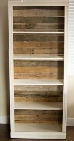 a way to refinish the orange shelving unit in the loft. pallet wood backed bookcase