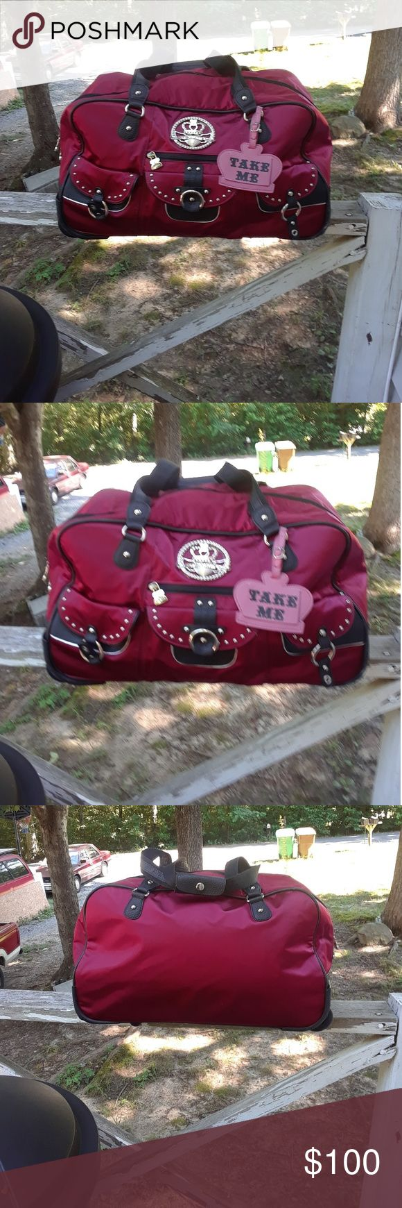 "Van Kathy Zeeland women's luggage This is a used Van Kathy Zeeland women's luggage.,it is dark pink light pink and black.it is 21"" in length,11"" in height and 10.5"" wide.it has 3 snap pockets and 1 small zipper pocket on the front.it has 2 open pockets and 1 small zipper pocket on the inside.it zips on top.it has a shoulder handle and retractable handle metal handle.it has 2 wheels for easy pulling.there is some sign of use.there are no holes or tears on either or stains.Please view the…"