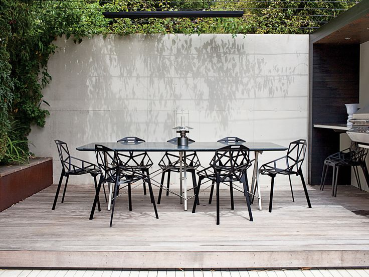 A raised dining nook furnished with Konstantin Grcic Ones for Magis makes outdoor dining a breeze. Photo by: Dustin Aksland