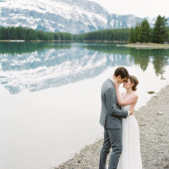New year, new month! It is a huge month for engagements and wedding planning so we're going to spend January sharing some of our favourite shots from real weddings and inspiration shoots over the last year! #EWGroom Repost : @staceyfoleydesign  Photography: @kaylayestal | Design & Styling: @staceyfoleydesign | Beauty: @simplymecanmore | Dress: @sarahseven from @thebridalboutiqueyyc | Lace Romper: @adorncalgary | Paper Goods & Calligraphy: @artandalexander | Cake: @prettysweetyyc | Florals…