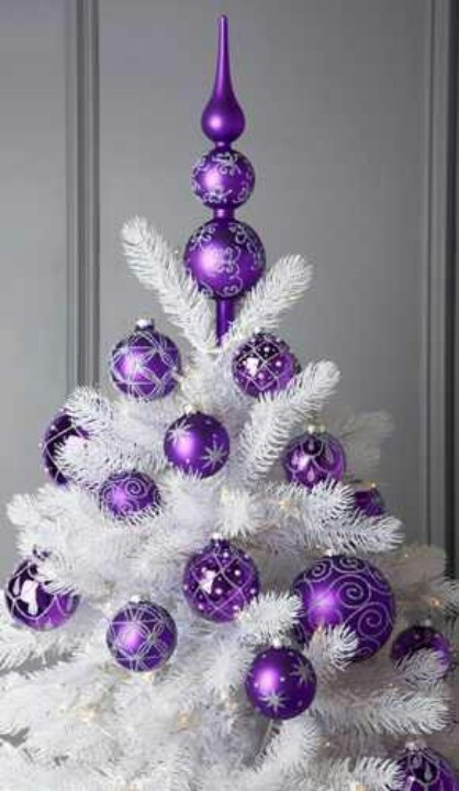 Purple ornaments on a white tree! Love the look but my hubby probably wouldn't like.