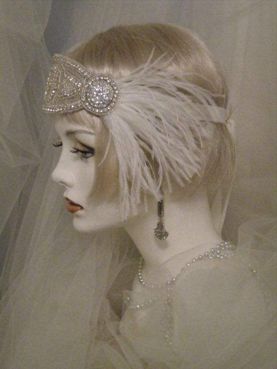 """From the studio of Elise Victoria READY TO SHIP WITHIN 3 TO 5 BUSINESS DAYS !!!  """"PRIORITY MAIL"""" WITH THE USPS - ALLOW APPROXIMATELY 2 TO 3 BUSINESS DAYS DELIVERY TIME!   The silver is a true bright silver. May show darker on your screen. Crystal Rhinestones are clear.  This dazzling Art Deco styled headband is made of an assortment of silver beads and clear crystal rhinestones. The stones catch the light of day or evening exquisitely. The headpiece is attached to an IVORY colored velvet (…"""