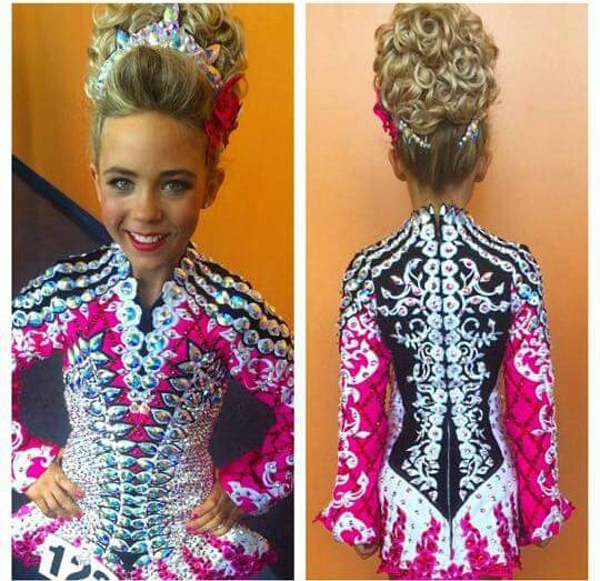 Alliyah O'hare 2015 u12 world champion. Holy crap that dress is amazing I almost love the back more than the front. Almost