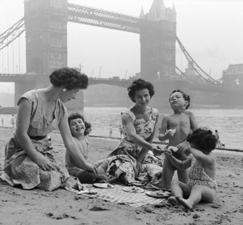 Mothers and their little ones enjoying a beach outing in London, England. #vintage #beach #summer #mother #kids #children #1950s (This would NEVER happen now!)