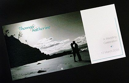 These romantic wedding invitations have a photo of an embracing couple on the edge of the ocean. www.kardella.com