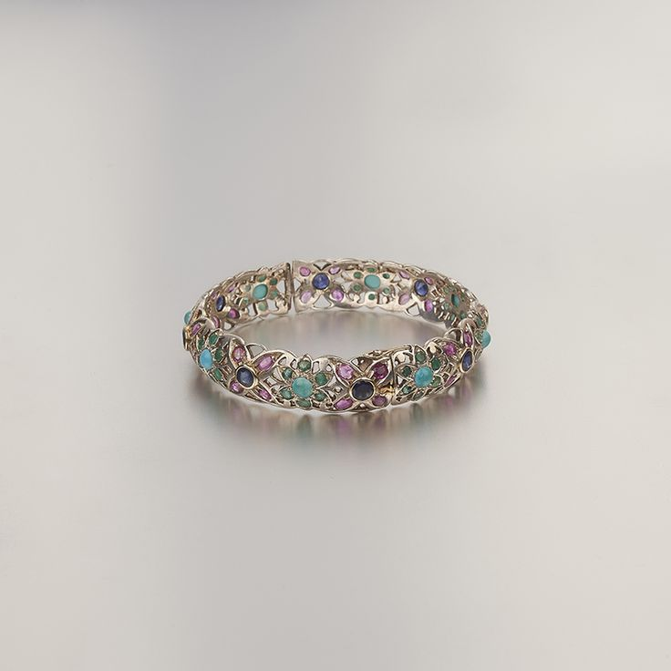 Beautiful craftsmanship in silver & 18k gold, with rubies, emeralds and sapphires.
