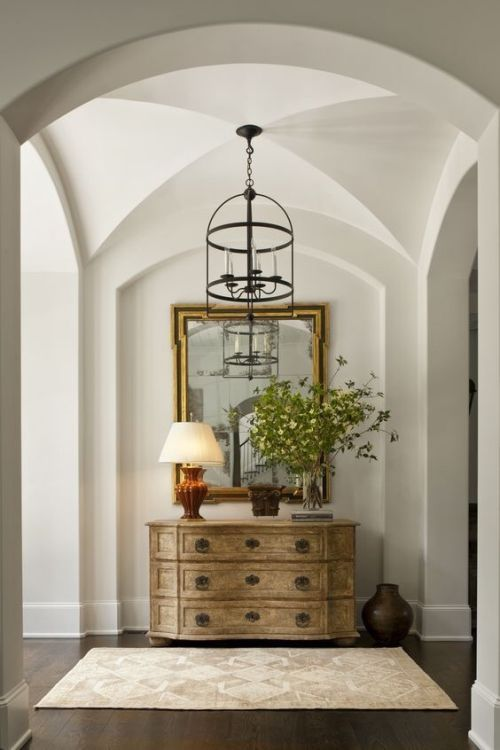Foyer with barrel vaulted ceiling.