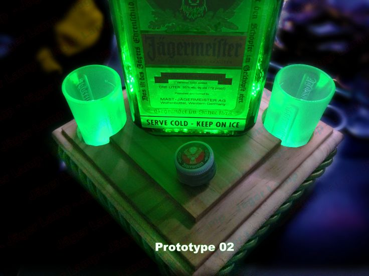 Jäger Lamp for sale in early 2014. Prototype 2 base with backlit bottle, shot glasses, and light mode switch. Jagermeister Lamp #jagerlamp . See more info at https://www.facebook.com/JagerLamp