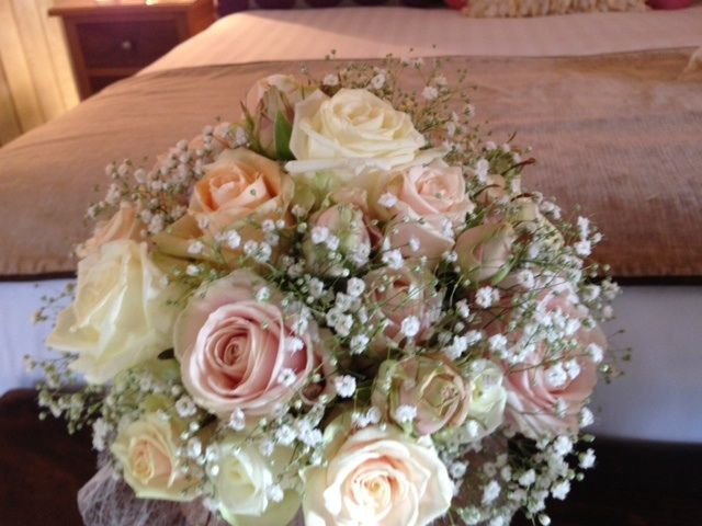 Example bouquet using roses and gypsophila (it's too big for you and feels a bit formal without the foliage and freesia)