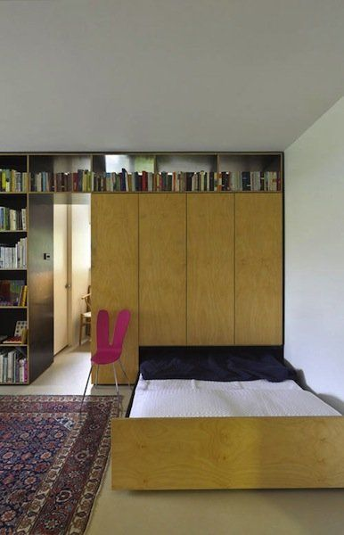 Anthony Gill Architects helped one family maximize their living space with a beautiful partition to divide rooms and hold belongings — inclu...