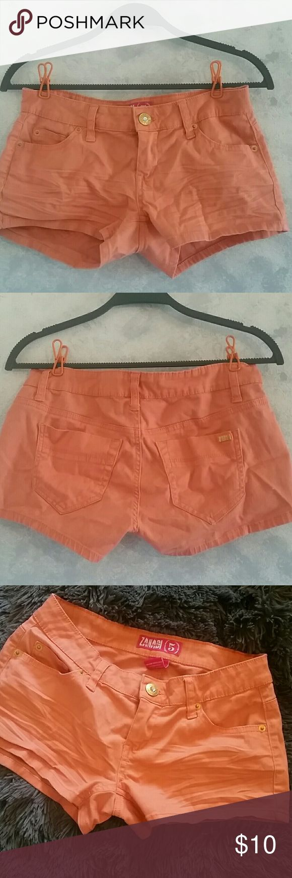 "CUTE! Peach shorts: perfect for summer! Super cute peach colored shorts with gold buttons. Size 5, measurements are...  Length: 9.5"" Waist: 14"" Inseam: 7""  Keep in mind that the camera quality is poor and could not capture the color very well, but the color is definitely more peachy than orange.  Feel free to comment any questions, offers are considered and packages sent ASAP! Zana Di Shorts"