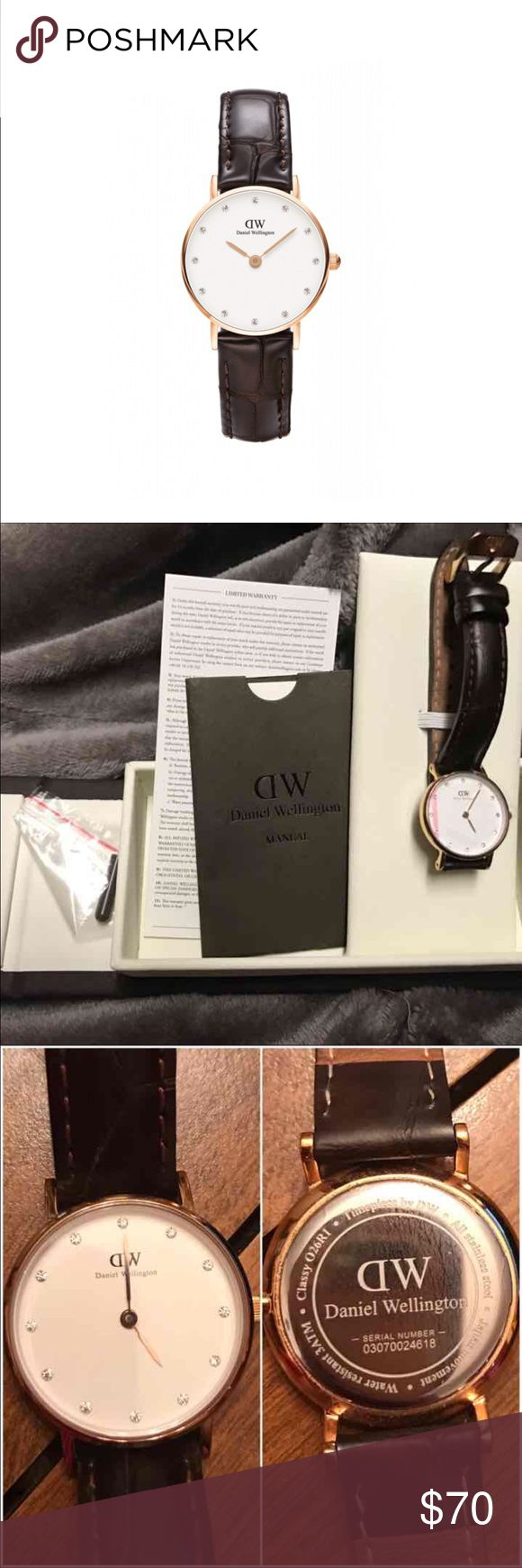 """Daniel Wellington 26mm Beautiful condition Authentic Daniel Wellington """"classy"""" 26mm with Swavorski crystals. Elegant and sleek watch is total classic piece. This has the leather crocodile strap and has been worn a few times. There are no cracks and rips in the leather. There is show of some wear in the leather strap in the 4th picture. There is nothing wrong with this, and is in perfect working condition. Comes with original box, manual, warranty, and screw driver. Price is negotiable…"""