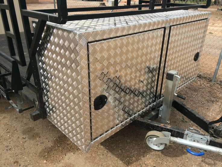 Storage box for car trailer with a unique feature.